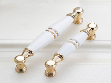 China Gold Cupboard Pull Ceramic Handles And Knobs White Porcelain Drawer Knob Village Design supplier